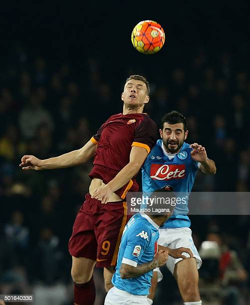Raul Albiol of Napoli competes for the ball with Edin Dzeko of Roma during the Serie A match betweeen SSC Napoli and AS Roma at Stadio San Paolo on...