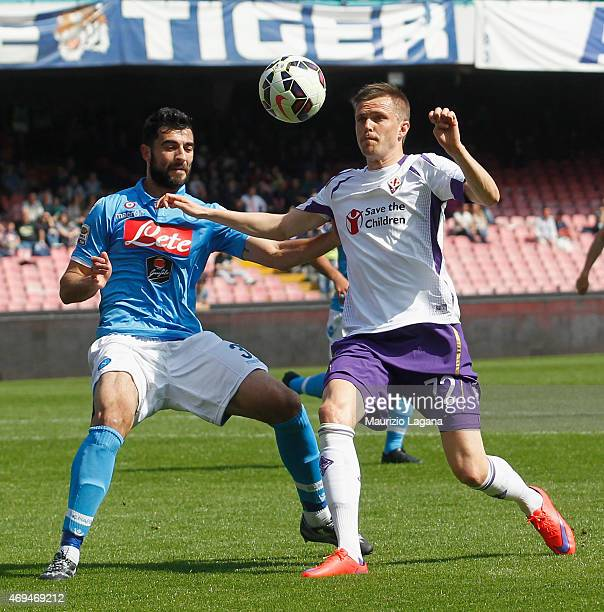 Raul Albiol of Napoli competes for the ball with Josip Ilicic of Fiorentina during the Serie A match between SSC Napoli and ACF Fiorentina at Stadio...