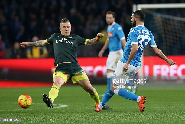 Raul Albiol of Napoli competes for the ball with Juraj Kucka of Milan during the Serie A between SSC Napoli and AC Milan at Stadio San Paolo on...