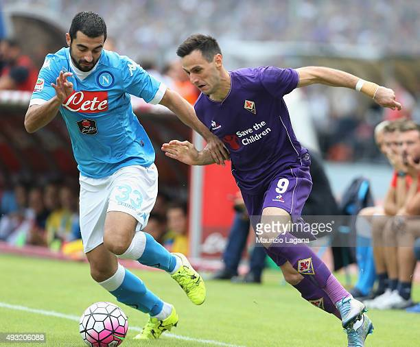 Raul Albiol of Napoli competes for the ball with Nikola Kalinic of Fiorentina during the Serie A match between SSC Napoli and ACF Fiorentina at...