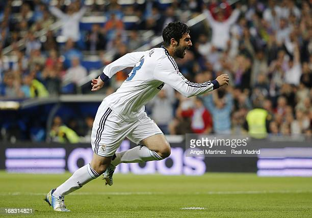 Raul Albiol of Real Madrid celebrates after scoring the opening goal during the La Liga match between Real Madrid and Malaga at Estadio Santiago...