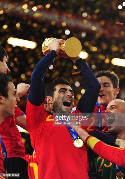 Raul Albiol of Spain lifts the World Cup after the 2010 FIFA World Cup South Africa Final match between Netherlands and Spain at Soccer City Stadium...