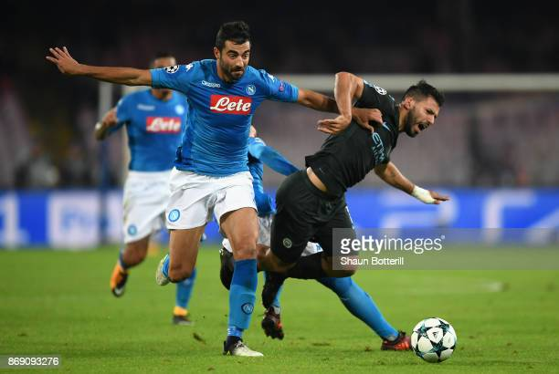 Raul Albiol of SSC Napoli and Sergio Aguero of Manchester City battle for possession during the UEFA Champions League group F match between SSC...