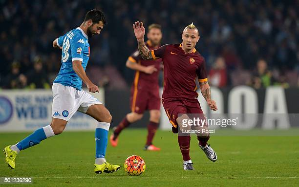 Raul Albiol of SSC Napoli is challenged by Radja Nainggolan of AS Roma during the Serie A match between SSC Napoli and AS Roma at Stadio San Paolo on...