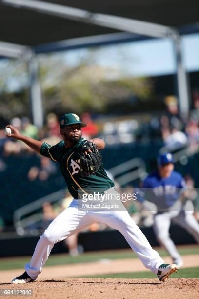 Raul Alcantara of the Oakland Athletics bats during the game against the Texas Rangers at Hohokam Stadium on March 2 2017 in Mesa Arizona