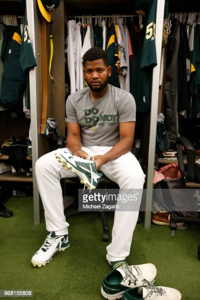 Raul Alcantara of the Oakland Athletics gets dressed in the clubhouse prior to the game against the Los Angeles Angels of Anaheim at the Oakland...