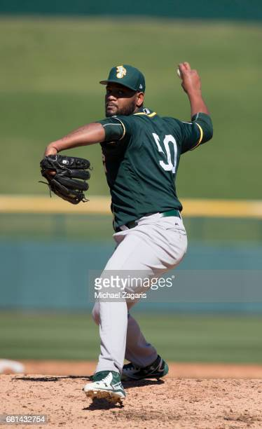 Raul Alcantara of the Oakland Athletics pitches during a game against the Chicago Cubs at Solan Park on February 25 2017 in Mesa Arizona