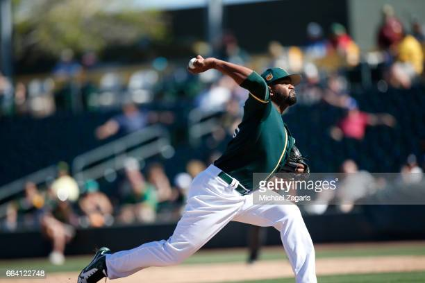 Raul Alcantara of the Oakland Athletics pitches during the game against the Texas Rangers at Hohokam Stadium on March 2 2017 in Mesa Arizona