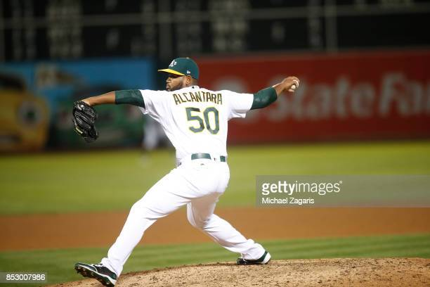 Raul Alcantara of the Oakland Athletics pitches during the game against the Houston Astros at the Oakland Alameda Coliseum on September 8 2017 in...