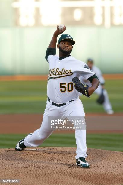Raul Alcantara of the Oakland Athletics pitches in the first inning against the Texas Rangers at Oakland Alameda Coliseum on September 23 2017 in...