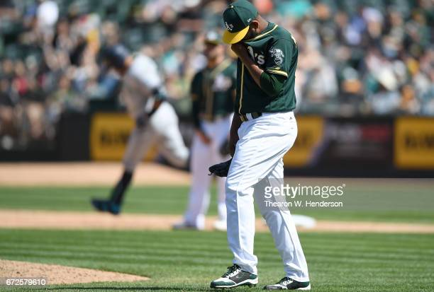 Raul Alcantara of the Oakland Athletics reacts after giving up a threerun homer to Nelson Cruz of the Seattle Mariners in the top of the seventh...