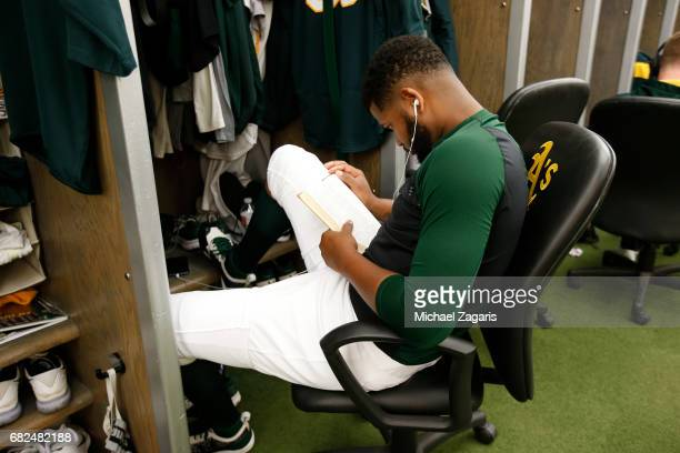 Raul Alcantara of the Oakland Athletics reads the Bible in the clubhouse prior to the game against the Seattle Mariners at the Oakland Alameda...