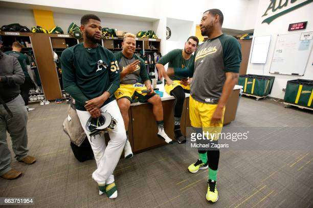Raul Alcantara Yairo Munoz and Renato Nunez of the Oakland Athletics talk in the clubhouse prior to the game against the Cleveland Indians at Hohokam...