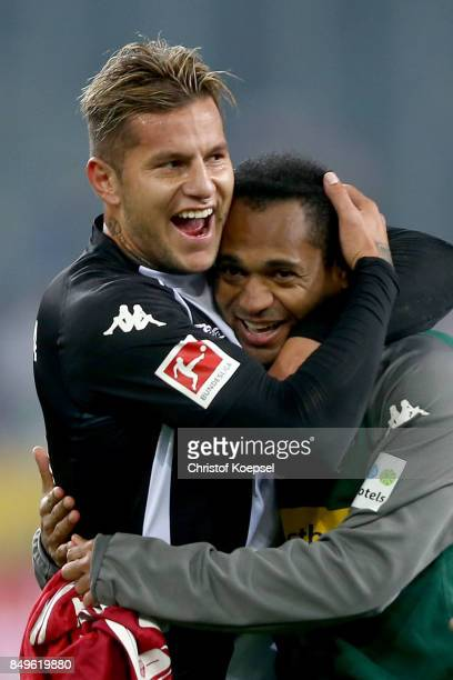 Raul Bobadilla and Raffael of Moenchengladbach celebrate after the Bundesliga match between Borussia Moenchengladbach and VfB Stuttgart at...