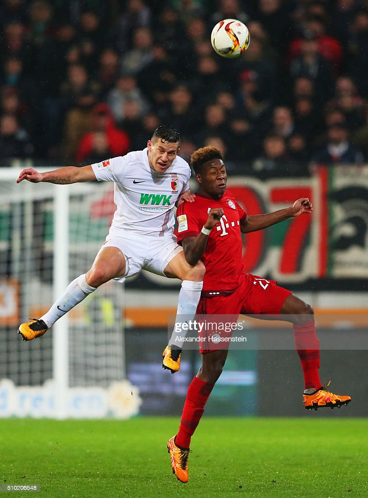 <a gi-track='captionPersonalityLinkClicked' href=/galleries/search?phrase=Raul+Bobadilla&family=editorial&specificpeople=5967534 ng-click='$event.stopPropagation()'>Raul Bobadilla</a> of Augsburg and <a gi-track='captionPersonalityLinkClicked' href=/galleries/search?phrase=David+Alaba&family=editorial&specificpeople=5494608 ng-click='$event.stopPropagation()'>David Alaba</a> of Bayern Munich jump for the ball during the Bundesliga match between FC Augsburg and FC Bayern Muenchen at SGL Arena on February 14, 2016 in Augsburg, Germany.
