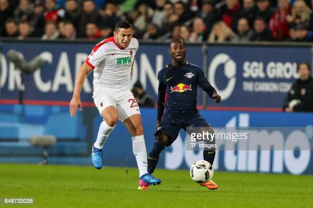 Raul Bobadilla of Augsburg and Naby Deco Keita of Leipzig battle for the ball during the Bundesliga match between FC Augsburg and RB Leipzig at WWK...