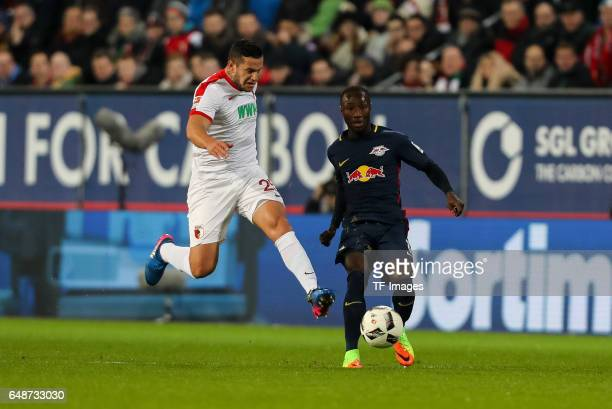Raul Bobadilla of Augsburg and Naby Deco Keitaund of Leipzig battle for the ball during the Bundesliga match between FC Augsburg and RB Leipzig at...