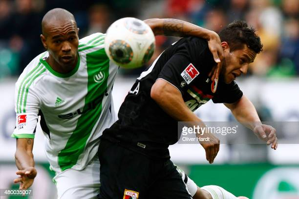 Raul Bobadilla of Augsburg and Naldo of Wolfsburg compete for the ball during the Bundesliga match between and VfL Wolfsburg and FC Augsburg at...
