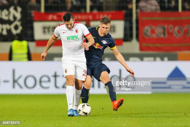 Raul Bobadilla of Augsburg and Willi Orban of Leipzig battle for the ball during the Bundesliga match between FC Augsburg and RB Leipzig at WWK Arena...