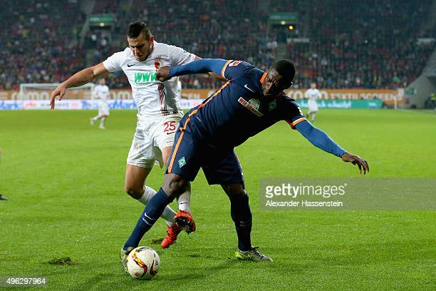 Raul Bobadilla of Augsburg battles for the ball with Assani Lukimya of Bremen during the Bundesliga match between FC Augsburg and SV Werder Bremen at...