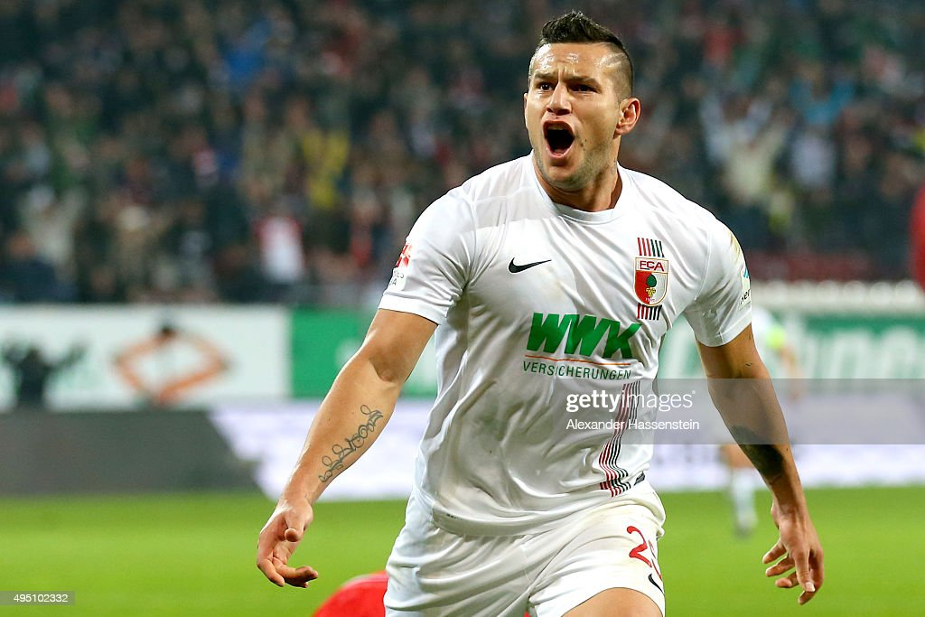 <a gi-track='captionPersonalityLinkClicked' href=/galleries/search?phrase=Raul+Bobadilla&family=editorial&specificpeople=5967534 ng-click='$event.stopPropagation()'>Raul Bobadilla</a> of Augsburg celebrates scoring the 3rd team goal during the Bundesliga match between FC Augsburg and 1. FSV Mainz 05 at WWK Arena on October 31, 2015 in Augsburg, Germany.