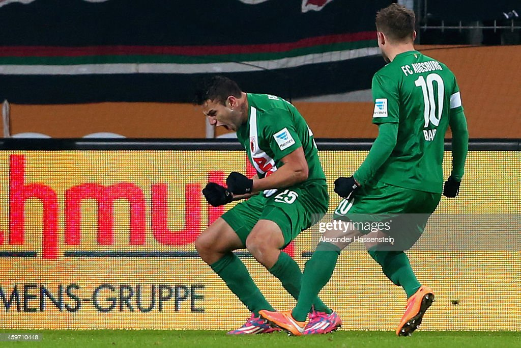 <a gi-track='captionPersonalityLinkClicked' href=/galleries/search?phrase=Raul+Bobadilla&family=editorial&specificpeople=5967534 ng-click='$event.stopPropagation()'>Raul Bobadilla</a> of Augsburg celebrates scoring the second team goal with his team mate <a gi-track='captionPersonalityLinkClicked' href=/galleries/search?phrase=Daniel+Baier&family=editorial&specificpeople=706624 ng-click='$event.stopPropagation()'>Daniel Baier</a> (R) during the Bundesliga match between FC Augsburg and Hamburger SV at SGL Arena on November 29, 2014 in Augsburg, Germany.