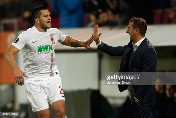 Raul Bobadilla of Augsburg celebrates with head coach Markus Weinzierl after scoring his team's 2nd goal during the UEFA Europa League group L...