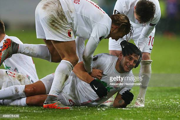 Raul Bobadilla of Augsburg celebrates with team mates as he scores their second goal with a header during the UEFA Europa League Group L match...