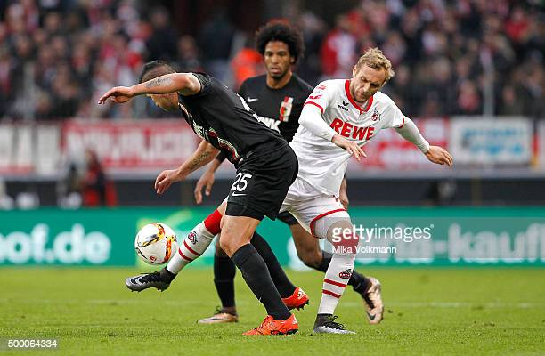 Raul Bobadilla of Augsburg challenges Marcel Risse of Cologne during the Bundesliga match between 1 FC Koeln and FC Augsburg at RheinEnergieStadion...