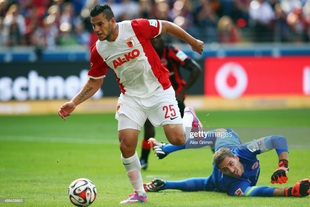 <a gi-track='captionPersonalityLinkClicked' href=/galleries/search?phrase=Raul+Bobadilla&family=editorial&specificpeople=5967534 ng-click='$event.stopPropagation()'>Raul Bobadilla</a> of Augsburg eludes goalkeeper <a gi-track='captionPersonalityLinkClicked' href=/galleries/search?phrase=Kevin+Trapp&family=editorial&specificpeople=4409868 ng-click='$event.stopPropagation()'>Kevin Trapp</a> of Frankfurt during the Bundesliga match between Eintracht Frankfurt and FC Augsburg at Commerzbank-Arena on September 14, 2014 in Frankfurt am Main, Germany.