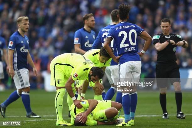 Raul Bobadilla of Augsburg gets injured during the Bundesliga match between FC Schalke 04 and FC Augsburg at VeltinsArena on March 12 2017 in...