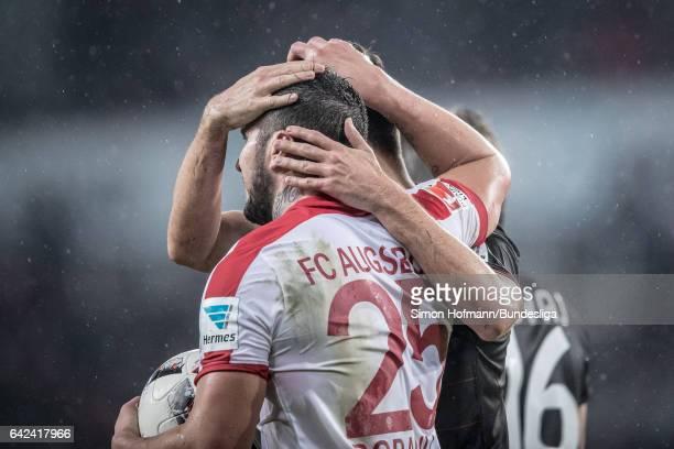 Raul Bobadilla of Augsburg hugs Tin Jedvai of Leverkusen during the Bundesliga match between FC Augsburg and Bayer 04 Leverkusen at WWK Arena on...