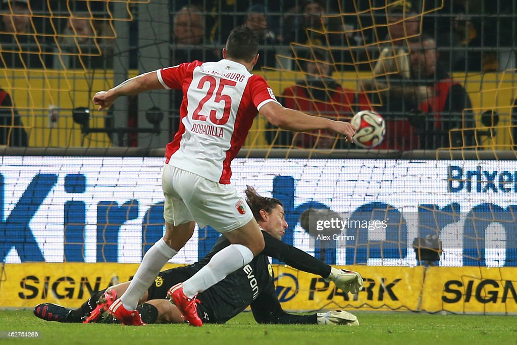 <a gi-track='captionPersonalityLinkClicked' href=/galleries/search?phrase=Raul+Bobadilla&family=editorial&specificpeople=5967534 ng-click='$event.stopPropagation()'>Raul Bobadilla</a> of Augsburg scores the opening goal against <a gi-track='captionPersonalityLinkClicked' href=/galleries/search?phrase=Roman+Weidenfeller&family=editorial&specificpeople=726753 ng-click='$event.stopPropagation()'>Roman Weidenfeller</a>, keeper of Dortmund during the Bundesliga match between Borussia Dortmund and FC Augsburg at Signal Iduna Park on February 4, 2015 in Dortmund, Germany.