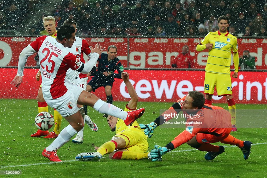 <a gi-track='captionPersonalityLinkClicked' href=/galleries/search?phrase=Raul+Bobadilla&family=editorial&specificpeople=5967534 ng-click='$event.stopPropagation()'>Raul Bobadilla</a> of Augsburg tries to score against Goalkeeper <a gi-track='captionPersonalityLinkClicked' href=/galleries/search?phrase=Oliver+Baumann&family=editorial&specificpeople=4645207 ng-click='$event.stopPropagation()'>Oliver Baumann</a> and Ermin Bicakcic of Hoffenheim during the Bundesliga match between FC Augsburg and 1899 Hoffenheim at SGL Arena on February 1, 2015 in Augsburg, Germany.