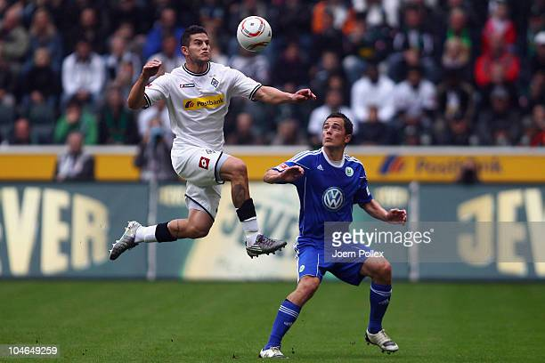 Raul Bobadilla of Borussia and Marcel Schaefer of Wolfsburg battle for the ball during the Bundesliga match between Borussia M'gladbach and VfL...