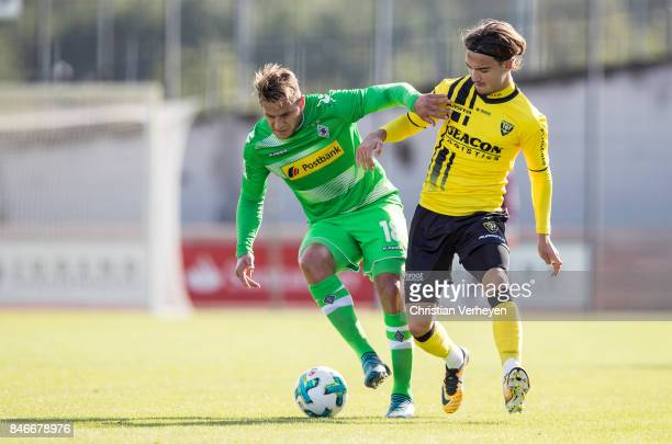 Raul Bobadilla of Borussia Moenchengladbach and Mink Peeters of VVV Venlo battle for the ball during a friendly match between Borussia...