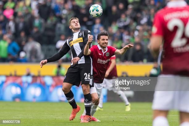 Raul Bobadilla of Borussia Monchengladbach Julian Korb of Hannover 96 during the Bundesliga match between Borussia Monchengladbach and Hannover 96 at...