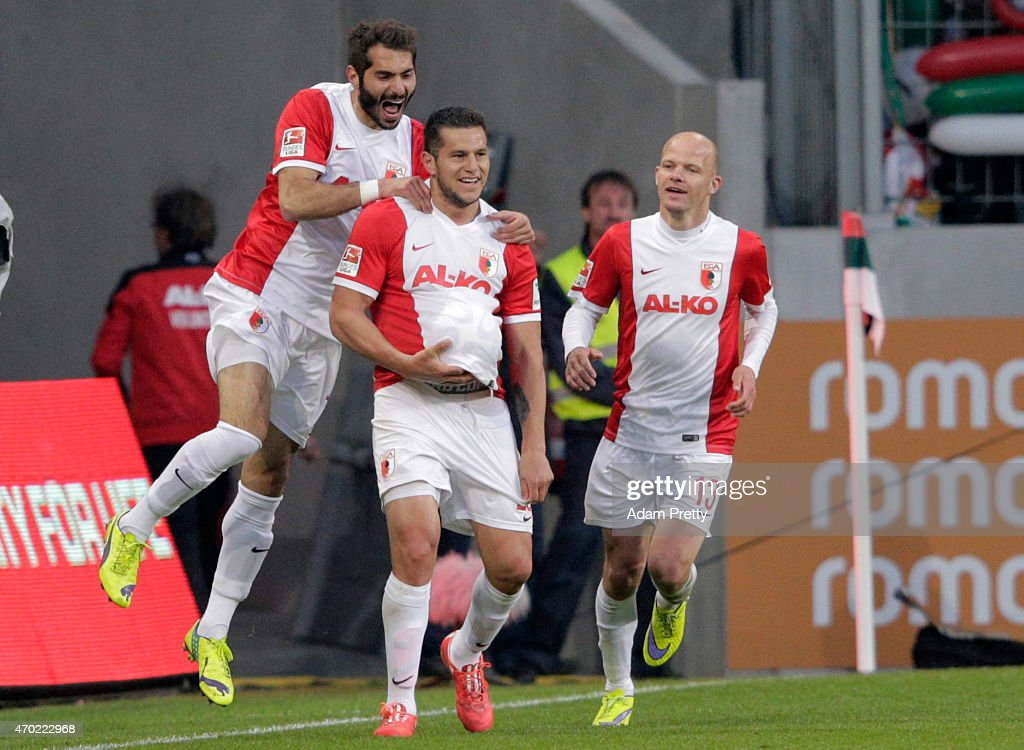 <a gi-track='captionPersonalityLinkClicked' href=/galleries/search?phrase=Raul+Bobadilla&family=editorial&specificpeople=5967534 ng-click='$event.stopPropagation()'>Raul Bobadilla</a> of FC Augsburg celebrates after he scores his team's 2nd goal during the Bundesliga match between FC Augsburg and VfB Stuttgart at SGL Arena on April 18, 2015 in Augsburg, Germany.