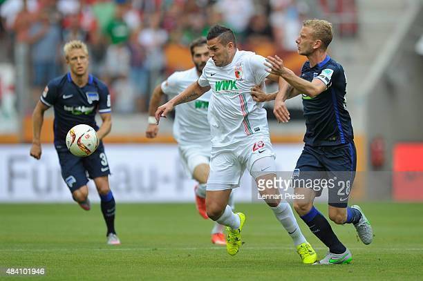 Raul Bobadilla of FC Augsburg challenges Fabian Lustenberger of Hertha BSC during the Bundesliga match between FC Augsburg and Hertha BSC at WWKArena...