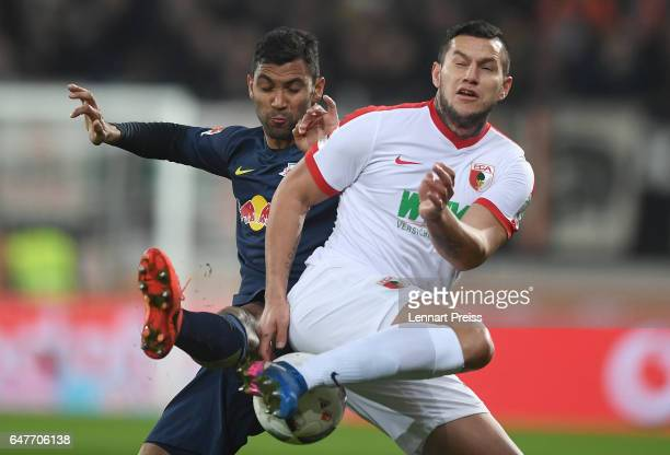 Raul Bobadilla of FC Augsburg challenges Marvin Compper of RB Leipzig during the Bundesliga match between FC Augsburg and RB Leipzig at WWK Arena on...