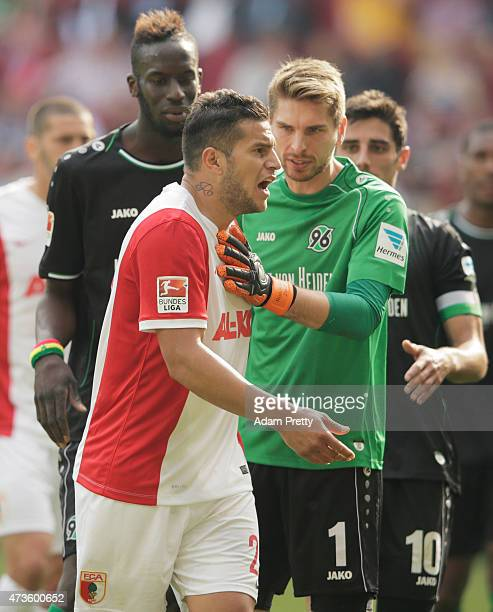 Raul Bobadilla of FC Augsburg is shown a red card during the Bundesliga match between FC Augsburg and Hannover 96 at SGL Arena on May 16 2015 in...
