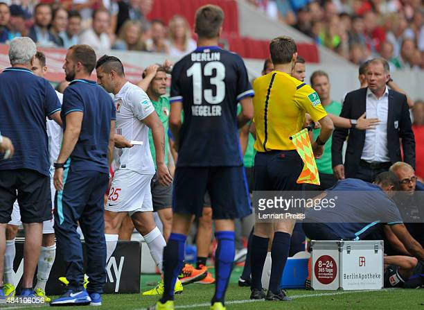 Raul Bobadilla of FC Augsburg leaves the pitch after a red card during the Bundesliga match between FC Augsburg and Hertha BSC at WWKArena on August...