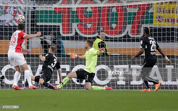 Raul Bobadilla of FC Augsburg scores his team's 2nd goal during the Bundesliga match between FC Augsburg and VfB Stuttgart at SGL Arena on April 18...