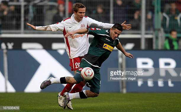 Raul Bobadilla of Gladbach and Niko Bungert of Mainz battle for the ball during the Bundesliga match between Borussia M'gladbach and FSV Mainz 05 at...