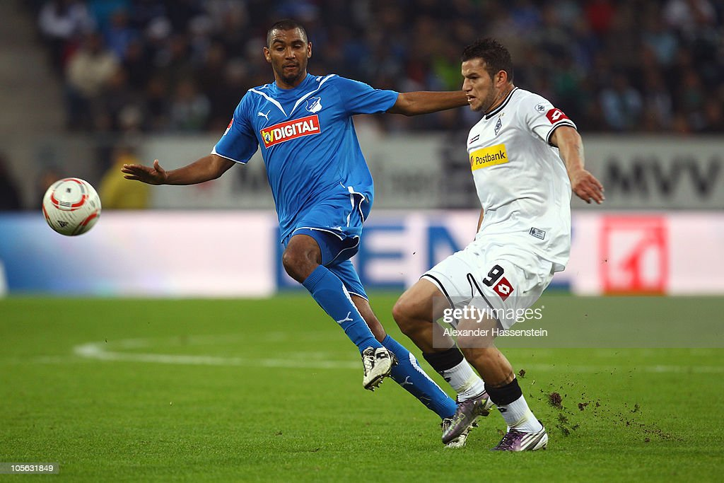 Raul Bobadilla(R) of Gladbach battles for the ball with Luiz Gustavo of Hoffenheim during the Bundesliga match between 1899 Hoffenheim and Borussia Moenchengladbach at Rhein-Neckar Arena on October 17, 2010 in Sinsheim, Germany.