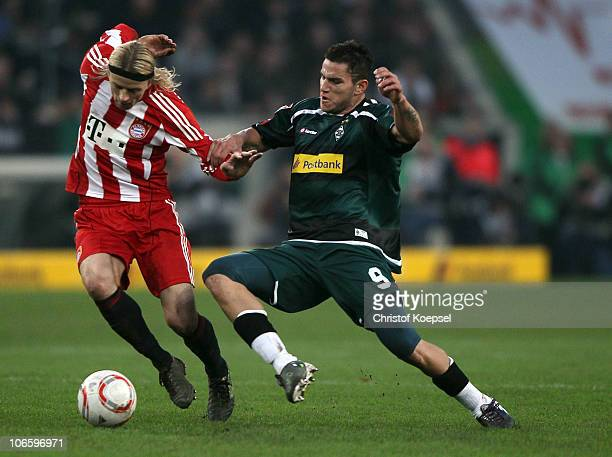 Raul Bobadilla of Gladbach challenges Anatolyi Tymoshchuk of Bayern during the Bundesliga match between Borussia Moenchengladbach and FC Bayern...