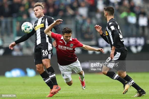 Raul Bobadilla of Moenchengladbach and Julian Korb of Hannover battle for the ball during the Bundesliga match between Borussia Moenchengladbach and...