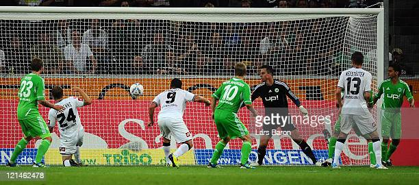 Raul Bobadilla of Moenchengladbach heads his teams third goal during the Bundesliga match between Borussia Moenchengladbach and VfL Wolfsburg at...
