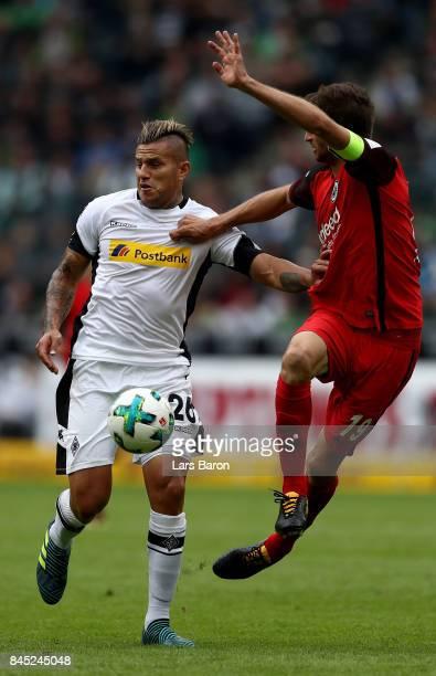 Raul Bobadilla of Moenchengladbach is challenged by David Abraham of Frankfurt during the Bundesliga match between Borussia Moenchengladbach and...