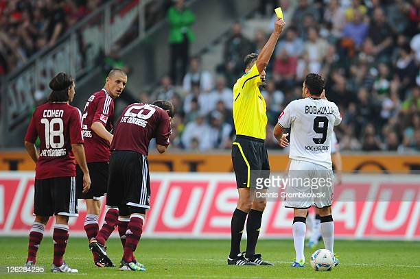 Raul Bobadilla of Moenchengladbach receives the yellow card during the Bundesliga match between Borussia Moenchengladbach and 1 FC Nuernberg at...